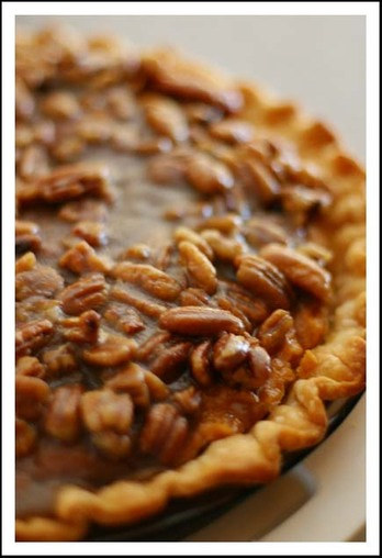 sweet potato pie with pecan topping.